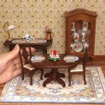 "A dollhouse room with needlepoint kits placemat and table-runner ""Crinoline Lady"""