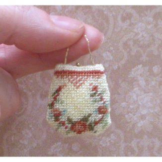 Dollhouse needlepoint handbag purse Rose reticule being held