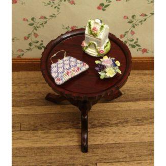 Dollhouse needlepoint handbag purse Shell pink accessories on table