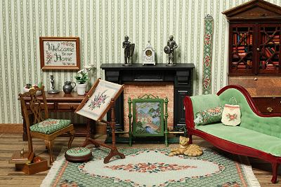 Dollhouse room showing a range of needlepoint items in the design Barbara green