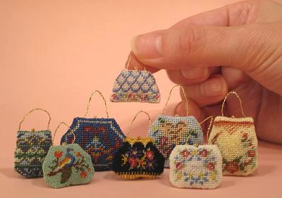 Group of several dollhouse needlepoint hanbags