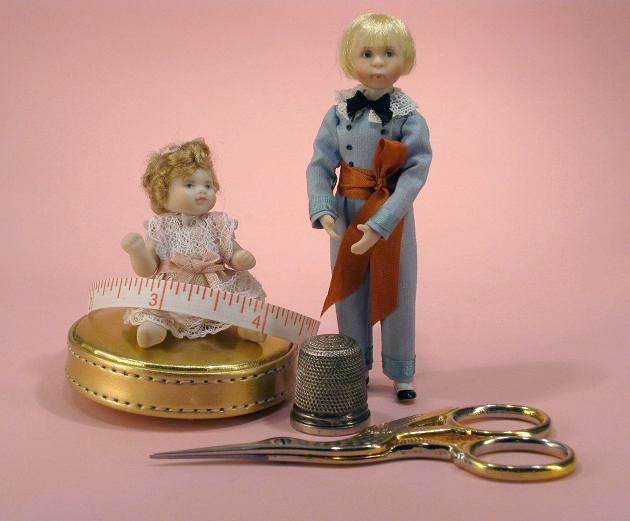 Picture of dollshouse scale dolls and sewing tools with tape measure to indicate the size of the 12th scale items