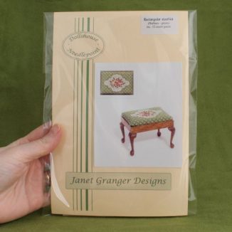 Dollhouse needlepoint Barbara green rectangular stool kit held in hand