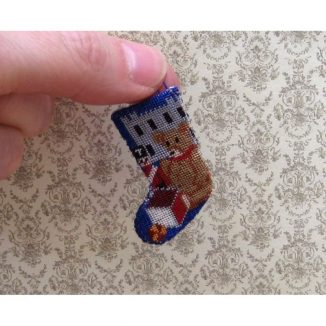 Dollhouse needlepoint Toys for Boys Christmas stocking being held