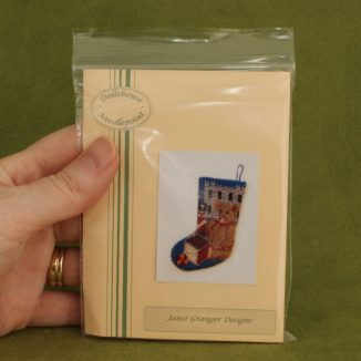 Dollhouse needlepoint Toys for Boys Christmas stocking kit in hand