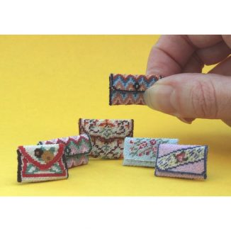 Dollhouse needlepoint clutch bags collection of all six