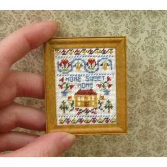 Dollhouse needlepoint sampler Home sweet home held for scale