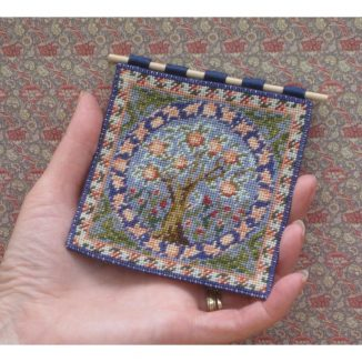Dollhouse needlepoint wall hanging Orange Tree being held