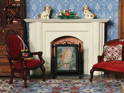 A dollhouse room with a firescreen