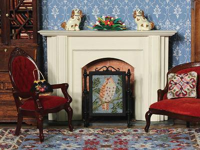 A dollhouse room with a firescreen