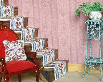 A needlepoint staircarpet on a dollhouse staircase