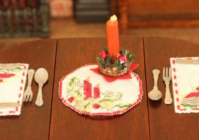 A table centre on a table in a dollhouse setting