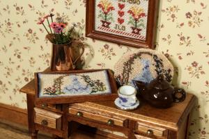 Needlepoint tray cloth in a dollhouse tea tray
