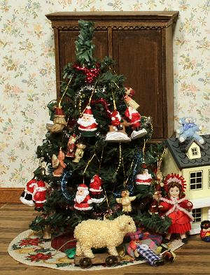 A dollhouse room with a Christmas tree mat under a Christmas tree