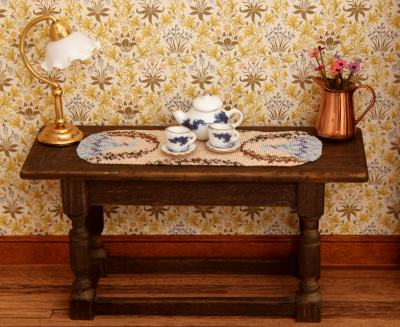 Dollhouse table runner on a sideboard