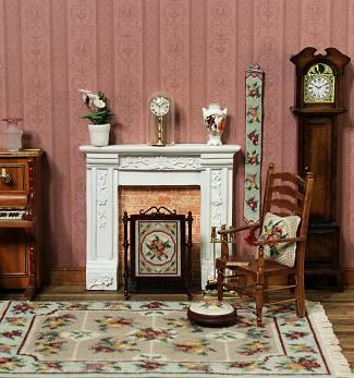A dollhouse room featuring some needlepoint kits