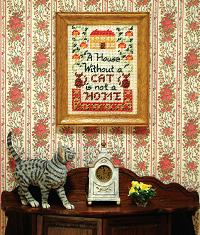 A dollhouse sampler on the wall