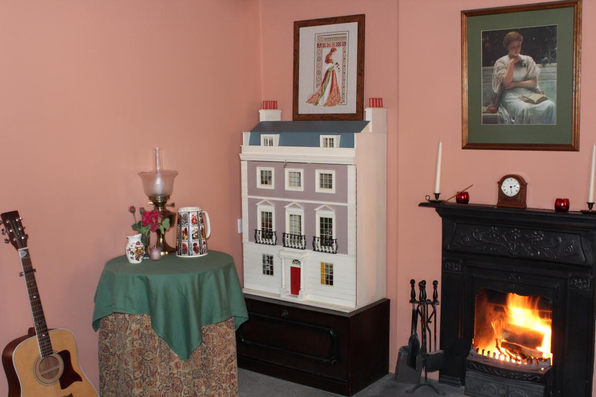 Janet's dollhouse in the corner of her living room