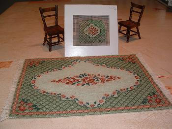 """Barbara (green)"" dollhouse needlepoint large carpet with matching chair seat being stitched"