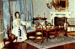 Dollhouse room with carpet and footstool
