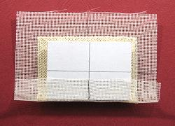 Miniature needlepoint tutorial - glue one edge of the gauze to the back of the cushion pad