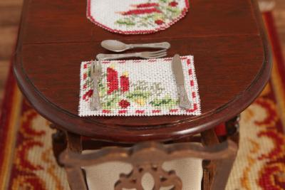 Dollhouse needlepoint placemat in a table place setting