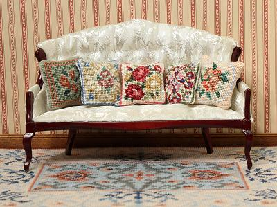 Miniature Needlepoint cushions on a settee