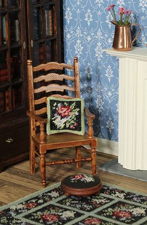Corner of a dollhouse room with a footstool