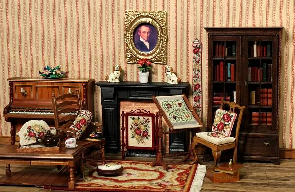 """A dollhouse room with many needlepoint items from Janet Granger's """"Summer Roses"""" range of kits"""