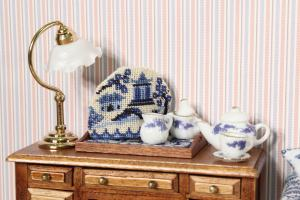 A Miniature Willow Pattern teacosy, with teapot