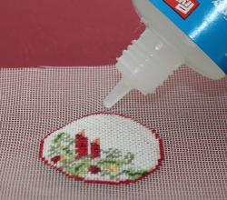Miniature needlepoint tutorial - run a line of fabric glue such as Fray Check around the edge