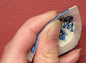 Miniature needlepoint tutorial - fold back the quarter inch seam allowance of bare gauze