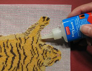 finishing the doll's house needlepoint 'tiger-skin' rug