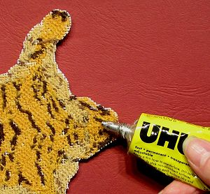 run a generous band of contact adhesive such as UHU around the edge