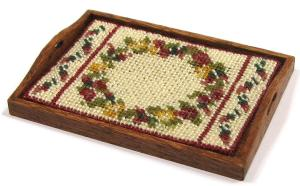Dollhouse needlepoint tutorial - the completed traycloth in a tray