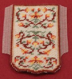 Miniature needlepoint tutorial - trim the unworked gauze to a quarter of an inch all round