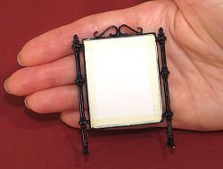 Dollhouse needlepoint tutorial - tape the card backing on the frame