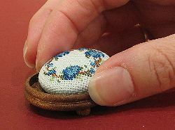 Dollhouse needlepoint tutorial - press the finished button into the wooden base