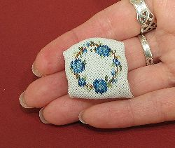 Dollhouse needlepoint tutorial - then fold the rest of the fabric