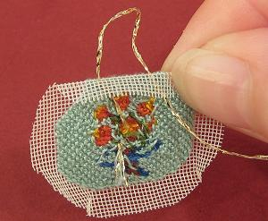 Miniature needlepoint tutorial - pass the needle down on the opposite side