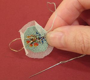 Miniature needlepoint tutorial - making two back stitches in the seam allowance