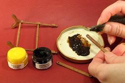 Dollhouse needlepoint tutorial - wax polish the frame uprights