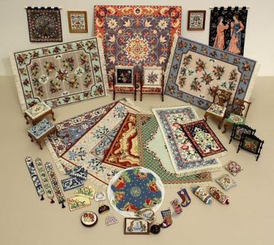 Display of dollshouse needlepoint kits by Janet Granger